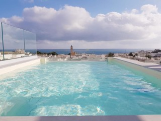 Penthouse with Pool, sea view in the center of S.M. of Leuca